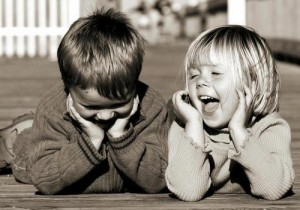 two-kids-laughing-in-black-and-whit-2-jpg